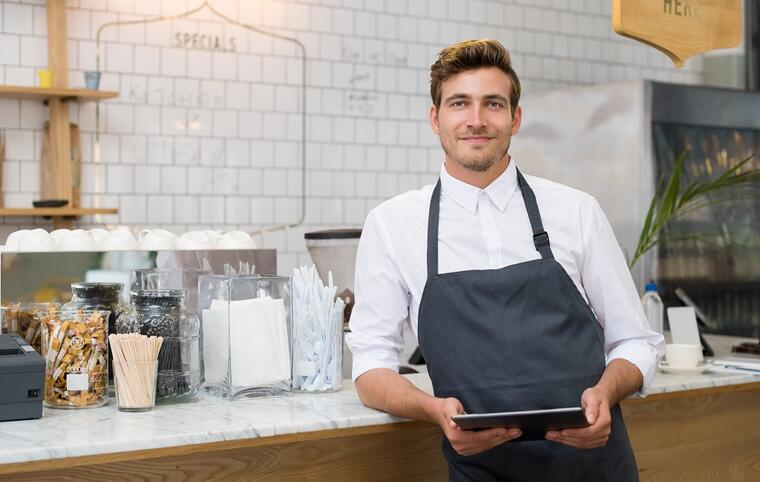 Restaurant owner with ipad