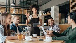 waitress greeting clients - restaurant management