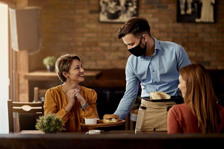 waiter with covid mask